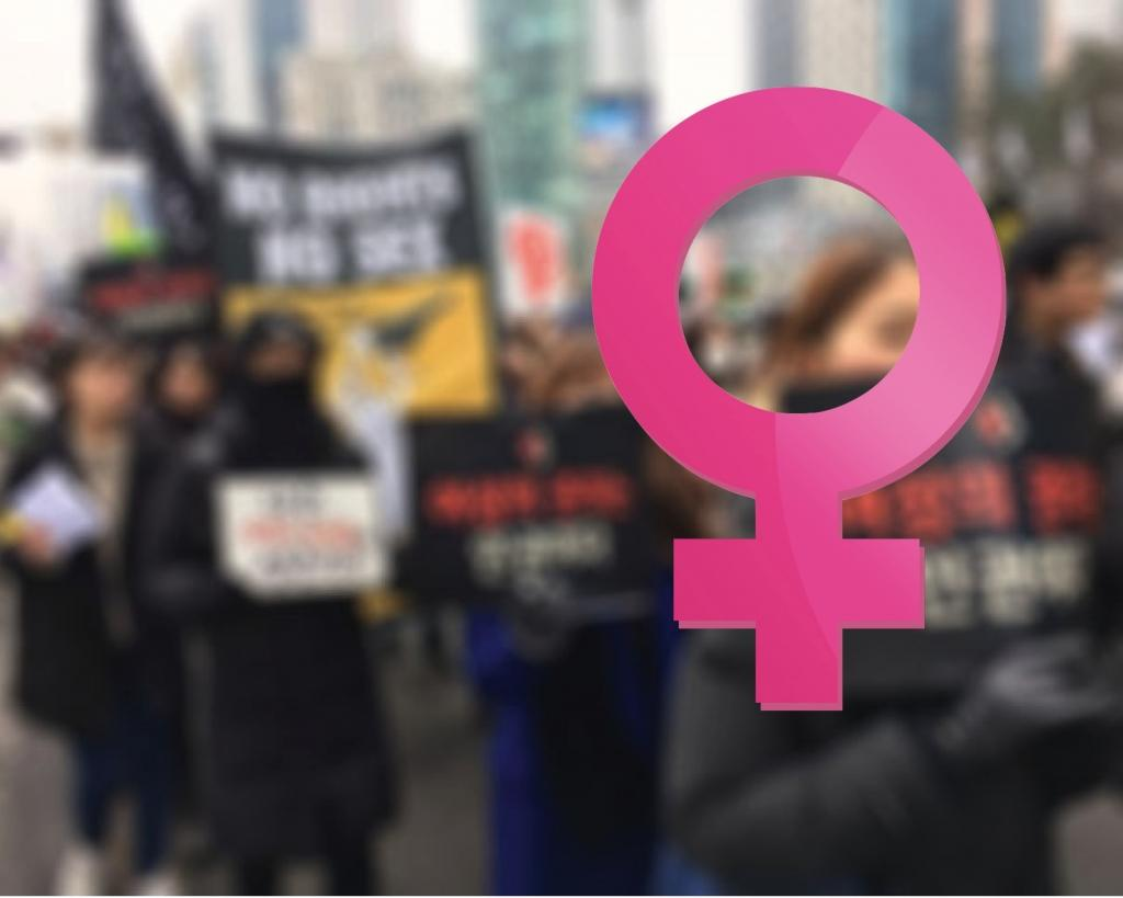 SIS teachers march for women's rights