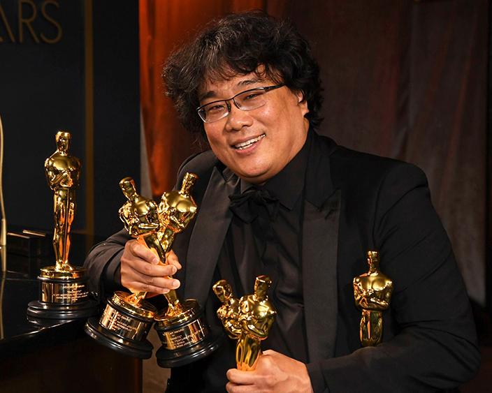 Mandatory Credit: Photo by Richard Shotwell/Invision/AP/Shutterstock (10552686aw) Bong Joon-ho holds the Oscars for best original screenplay, best international feature film, best directing, and best picture for Parasite at the Governors Ball after the Oscars, at the Dolby Theatre in Los Angeles 92nd Academy Awards - Governors Ball, Los Angeles, USA - 09 Feb 2020