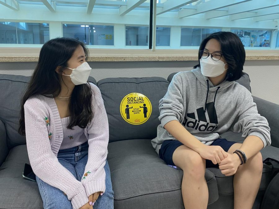 Matthew Um (right) and Seoyoon Choi (left) discuss ideas, just as they did for their podcast